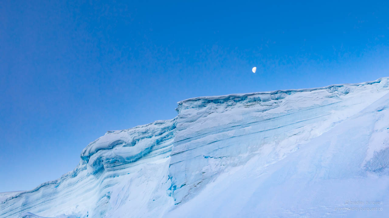 Moon over iceberg